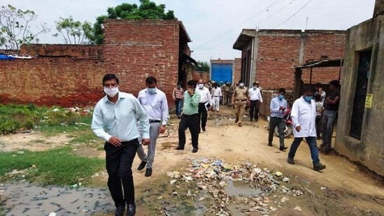 A Uttar Pradesh government official taking stock of the dengue situation in a village in Firozabad district.(HT Photo)