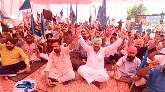 Members of the Punjab Roadways, Punbus and PRTC Contractual Workers' Union protesting against the state government in Bathinda on Monday.