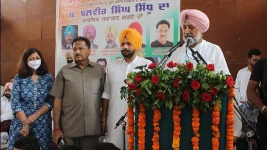 Punjab health and family welfare minister Balbir Singh Sidhu speaking at a function in Machhiwara, Ludhiana, on Monday. (HT PHOTO)