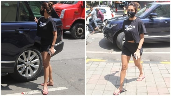 The star teamed the top with matching black biker shorts and pink-coloured flip flops.(HT Photo/Varinder Chawla)