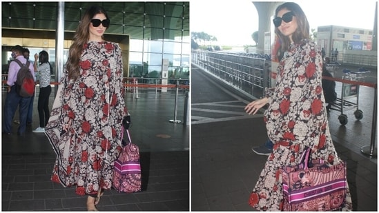 Mouni chose a floral printed anarkali suit set to board a flight out of Mumbai. The anarkali kurta, replete with black, off-white and red flowers, featured a cinched waistline, half sleeves, and silver patti border on the neckline.(HT Photo/Varinder Chawla)