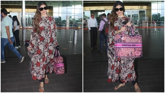 Mouni also carried a Christian Dior Book Tote Embroidered Canvas Bag with her airport ensemble. The luxurious bag is worth <span class=