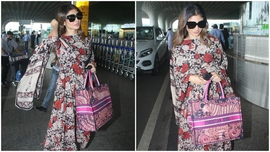 Today, Mouni was snapped by the paparazzi at the airport in a printed suit set. She made a case for floral prints in her effortlessly comfortable ensemble, and we are taking notes.(HT Photo/Varinder Chawla)