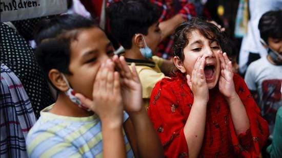 Children shout slogans, as Afghan nationals attend a protest outside the United Nations High Commissioner for Refugees (UNHCR) office to urge the international community to help Afghan refugees, in New Delhi, India, September 1, 2021. REUTERS/Adnan Abidi (REUTERS)