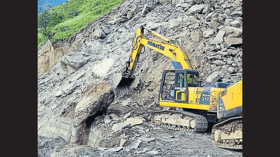 Boulders being removed during the restoration work of the Shimla-Kinnaur highway on Tuesday which was closed due to a landslide at Jeori. (ANI)