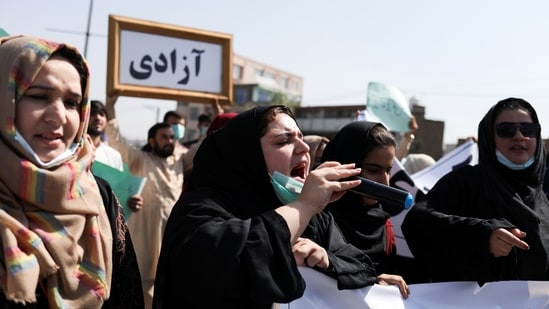 An Afghan woman uses a microphone to chant during the anti-Pakistan protest in Kabul, Afghanistan.(REUTERS)