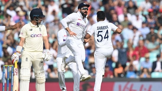 Shardul Thakur (R) celebrates after taking the wicket of England's Rory Burns during the fifth day of the Oval Test(Twitter)
