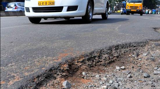 At least 2,000 kms of roads in the city are damaged or have potholes, according to the state government, which have cost many lives over the years. (Samuel Rajkumar)