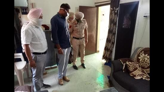 Punjab Police at the crime scene in Phase 11, Mohali, on Tuesday.