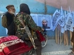 Members of Taliban forces gather and look at the picture of their leader Mullah Haibatullah Akhundzada, in Kabul.(Reuters Photo)