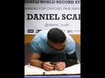 Daniel Scali from Australia created the longest abdominal plank record.(Instagram/@guinnessworldrecords)