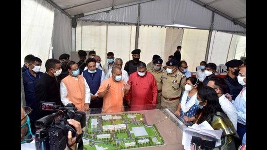 Uttar Pradesh chief minister Yogi Adityanath looking at the model of the state university in Aligarh on Wednesday (HT photo)