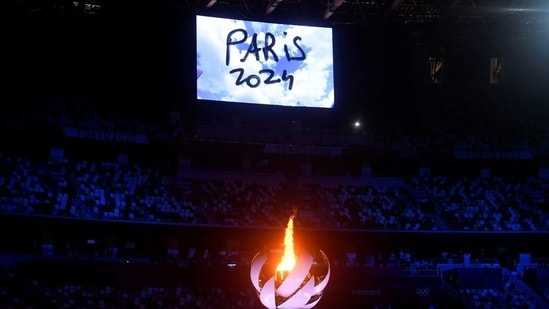The Tokyo 2020 Olympics Closing Ceremony - Olympic Stadium, Tokyo, Japan - August 8, 2021. The Olympic torch and cauldron are seen with Paris 2024 displayed on the big screen during the closing ceremony.(REUTERS)