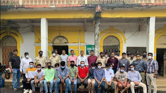 Police with the gang in Goa on Wednesday. (Sourced)