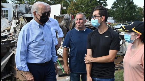 US President Joe Biden (left) tours a neighbourhood affected by Hurricane Ida in Manville, New Jersey on Wednesday. (AFP)