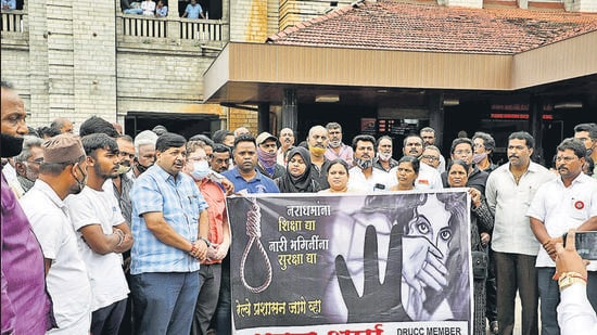 Members of the railway users' consultative committee held a protest at the Pune railway station on Tuesday, to condemn the kidnapping and gang-rape of the minor. (HT)