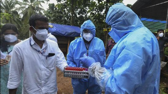 Health workers collect blood samples from goats for testing after a 12-year-old boy died of the Nipah virus in Kozhikode, Kerala. (AP)