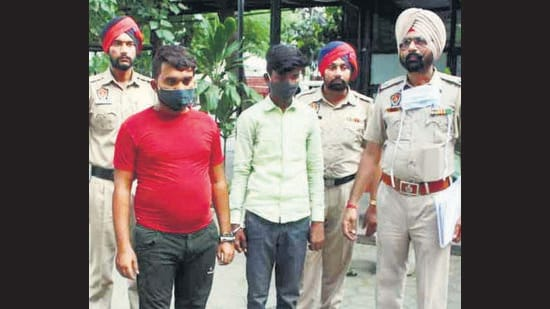 Two members of an inter-state gang in custody of Khanna police on Wednesday. (HT Photo)
