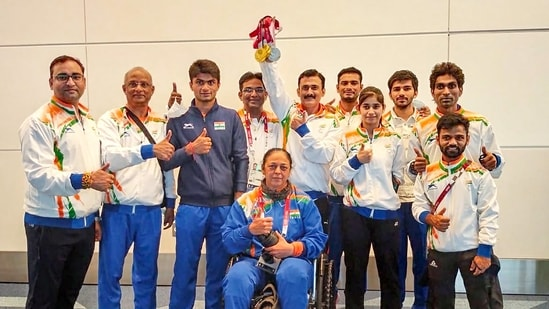 New Delhi: Badminton medalists of the Tokyo Paralympics with team coach pose for photographs on their arrival in New Delhi, Monday, Sept 6, 2021.(PTI)