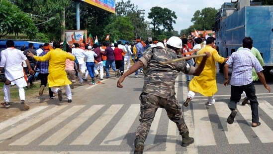 Police personnel use lathicharge on BJP protesters during Jharkhand Assembly march as they protest against Chief Minister Hemant Soren and Assembly Speaker Rabindra Nath Mahato after allotting a room in the Jharkhand Assembly House to offer Namaz.(PTI)