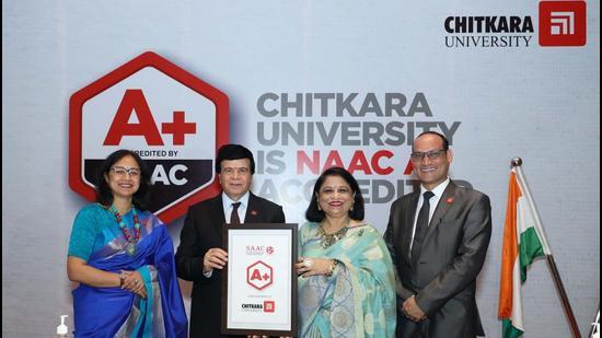 Chitkara University Chancellor Ashok K Chitkara and Pro Chancellor Madhu Chitkara showing the NAAC A+ certificate received by the varsity. (HT Photo)