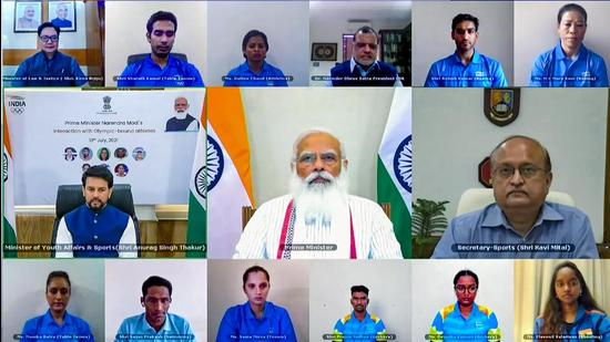 Prime Minister Narendra Modi interactis with Indian athletes' contingent bound for Tokyo Olympics in July. The PM can legitimately claim that his government has done more than others in building an Olympic medal momentum. But political control over sport federations must be tackled . (PTI)