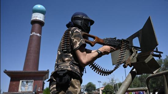 """A member of the Taliban Fateh, a """"special forces"""" unit, patrols on a vehicle at Massoud square in Kabul. (AFP)"""