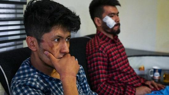 Afghan newspaper Etilaatroz journalists Neamat Naqdi (R) and Taqi Daryabi sit in their office after being released from Taliban custody in Kabul.(AFP)