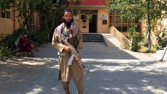 A Taliban fighter stands near a building in Panjshir province, northeastern of Afghanistan, on Wednesday.(AP Photo)