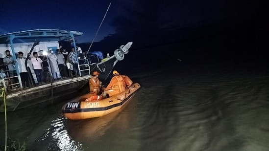 NDRF personnel conduct rescue operation after two boats carrying approximately 120 passengers collided in the Brahmaputra river in Jorhat on Wednesday.(ANI Photo)