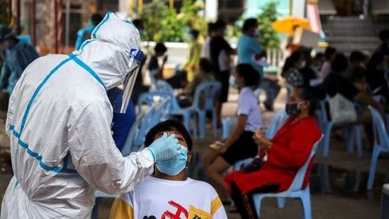 A healthcare worker takes a nasal swab sample from a person for a coronavirus disease (Covid-19) test, at a temple near Klong Toey slum community in Bangkok, Thailand(File Photo / REUTERS)