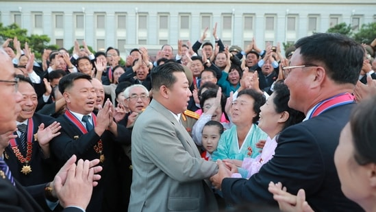 North Korean leader Kim Jong Un greets people during an event to mark the 73rd founding anniversary of North Korea in Pyongyang.(via Reuters)