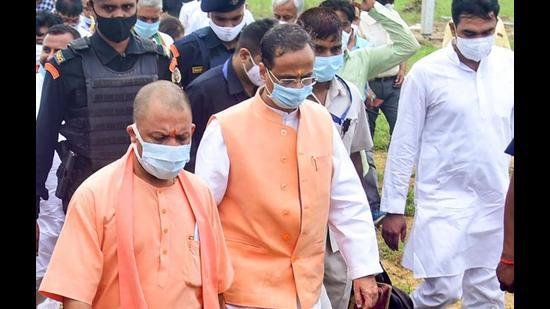 UP chief minister Yogi Adityanath inspects preparations for the inauguration of Raja Mahendra Pratap State University at village Lodha, in Aligarh, Wednesday, (PTI Photo)