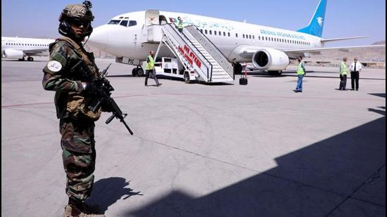 A member of Taliban forces stands guard next to a plane at Hamid Karzai International Airport in Kabul. America's credibility might have been stonewashed in Afghanistan, but there is little reassurance needed to those nations committed to areas of interests well inside Biden's geopolitical wheelhouse. These interests include managing China, investing in Quadrilateral alliances, and doubling down on new marketplaces and opportunities in the Indo-Pacific. (REUTERS)