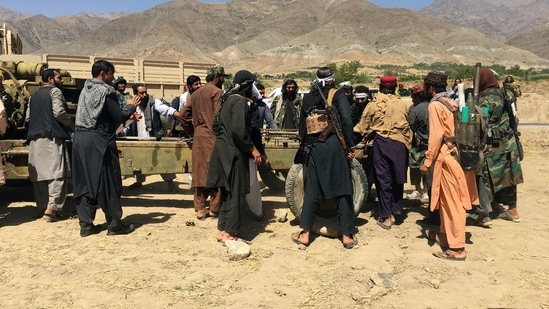 Taliban soldiers gather with weapons and machinery in Panjshir province.(AP)
