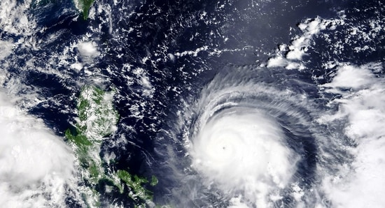Satellite image released by NASA, Typhoon Chanthu, right, develops into a powerful typhoon moving towards Taiwan, top left. Chanthu continues gaining strength and is expected to make landfall in Taiwan over the weekend.( AP)