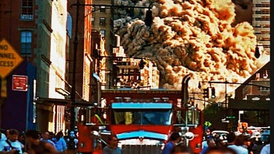 Image of the huge cloud of smoke and dust rising from the demolished twin towers of the World Trade Center displayed at an exhibition.(PTI)