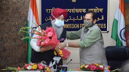 Union Minister for Minority Affairs Mukhtar Abbas Naqvi attends charge taking ceremony of National Commission for Minorities Chairman Sardar Iqbal Singh Lalpura in New Delhi.(PTI Photo)