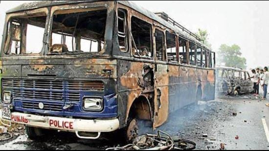 A police vehicle torched by protesters in the wake of sacrilege incidents in Faridkot district in 2015.