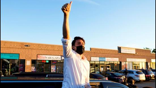 Canada's Prime Minister Justin Trudeau waves to supporters during his election campaign tour in Whitby, Ontario, on Friday. An unidentified man has been arrested and charged by police in the province of Ontario for threatening Justin Trudeau while he was campaigning in the town of Cambridge in late August. (REUTERS)