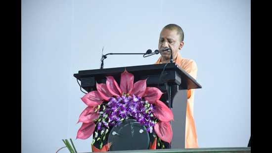 UP chief minister Yogi Adityanath speaking at the foundation stone-laying ceremony of the Uttar Pradesh National Law University, in Prayagraj, on Saturday. (HT Photo)