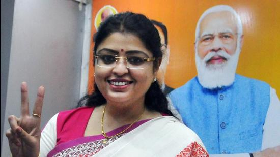 BJP's Priyanka Tibrewal flashes victory sign after the announcement of her name as the party candidate for Bhabanipur Assembly constituency, at state BJP headquarters, in Kolkata on Friday. (PTI)