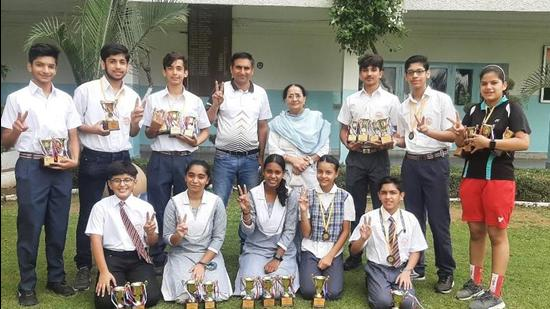 Students of BCM Arya School, Ludhiana, with their medals and trophies.