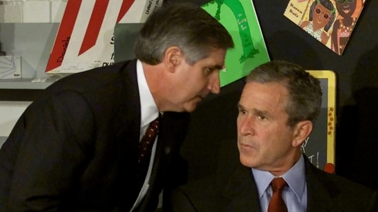 US President George W. Bush listens as White House Chief of Staff Andrew Card informs him of a second plane hitting the World Trade Center.(Reuters)