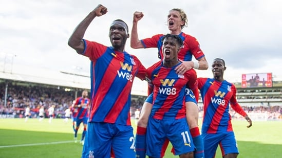 Wilfried Zaha celebrates with Christian Benteke, Conor Gallagher, Tyrick Mitchell after scoring a goal.(Getty)