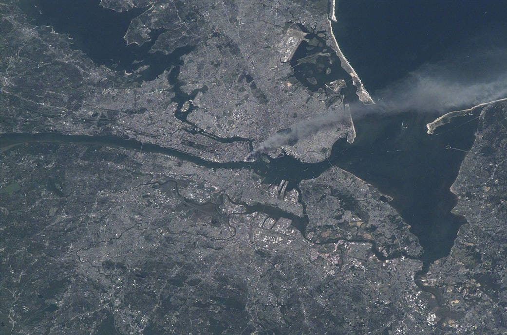A smoke plume rises from the Manhattan area after two planes crashed into the towers of the World Trade Center.(Nasa)