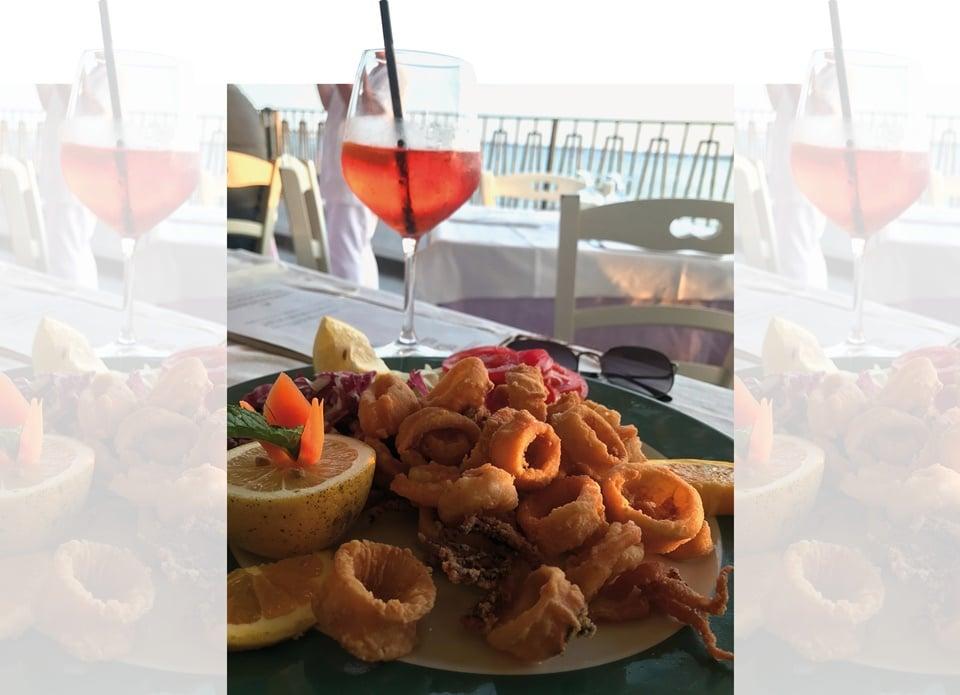 Aperitivo in Naples: Spritz cocktail with fried calamari(Photo by Natasha Celmi)