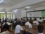 All educational institutions remained closed since March 2020 due to the surge in the number of coronavirus cases in the country. In this photo, students os Rajuk Uttara Model College, Dhaka can be seen attending an offline class.(AFP)