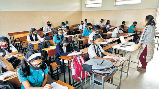 A school in Pune that reopened on February 1, 2021, before authorities announced that schools will remained closed following rise in Covid cases in the city. Readers suggest steps that should be taken to ensure all staff at private schools are fully vaccinated. (HT)