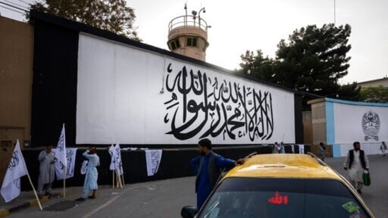 The iconic Taliban flag is painted on a wall outside the American embassy compound in Kabul on 9/11.(AP Photo)